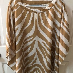 Tan and white animal print blouse